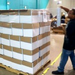 Workers shrink wrapping packages